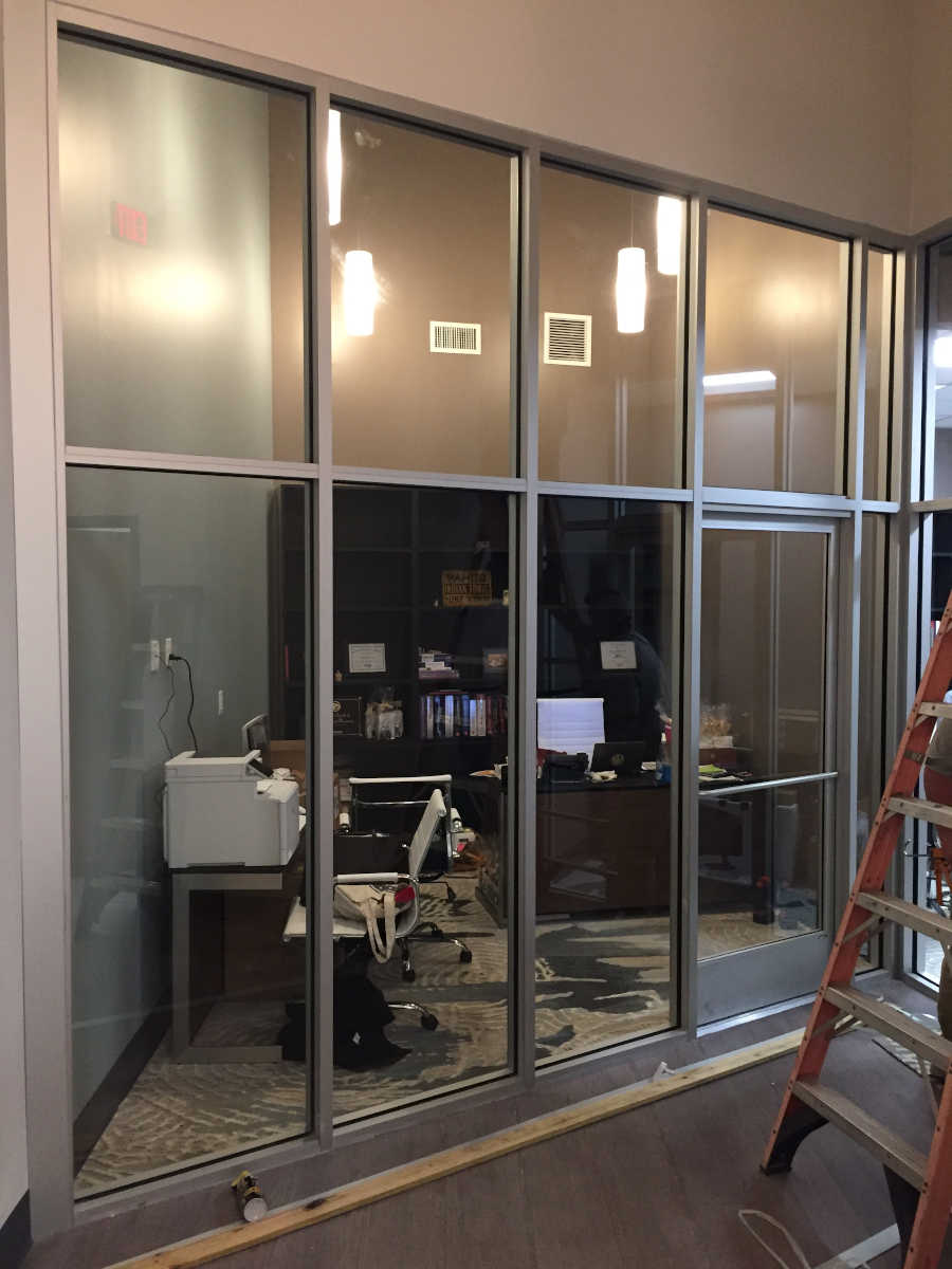 Glass wall being installed